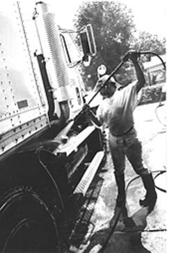 Bayousphere Stamp of approval: Latrecia Amos sprays down a U.S. postal truck at the Oil Can on North Wayside.
