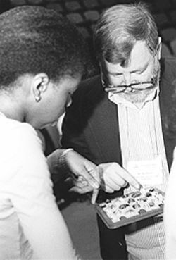 Bayousphere Barbara Jordan High ninth-grader Kim Smith ponders a logic puzzle with University of Houston-Downtown professor Randy Barnes, as part of the college's Prefreshman Enrichment Program.