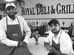 Saleh (left) and Syed got a quick lesson in how to open a restaurant.