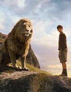 Christlike: Aslan, a giant magical lion with the voice of  Liam Neeson (pictured with Skandar Keynes as  Edmund).