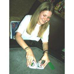 Michelle Holtz, from National Pub Poker League, deals the cards.