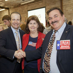 Lloyd Oliver shakes hands with Harris County Republican Chairman Jared Woodfill. Woodfill says he's had a good laugh over the Democrats' failed attempt to force Lloyd off the ticket.