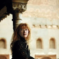 Loreena McKennitt: Queen of pan-Celtic music, high collars.