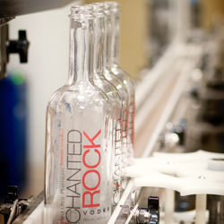 Rebecca Creek Distillery put out Enchanted Rock vodka to generate revenue while the bourbon ages.