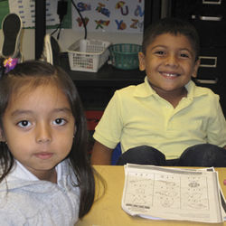 It's Spanish one week, English the next for kindergarten students Paola Lopez and  Jonathan Alfaro at SER-Niños, the dual-l­anguage charter school in the Gulfton neighborhood.
