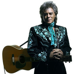 Marty Stuart can wear a suit of clothes.