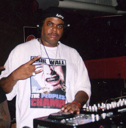Mike Jones got his start by making personalized songs for strippers. DJ Big Red, who worked at a local strip club, blew Jones off at first but eventually helped him get his first big break.