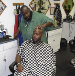 K.D., who was the Ice Age barber, says Jones treated his crew like his kids. K.D.'s brother C.T. (seated) was one of the first to fall out with Jones.