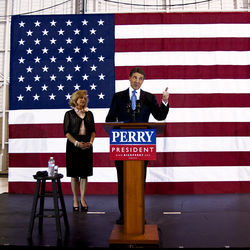 "On the campaign trail or at the debate podium, Perry cocks that cowboy smile and vows to ""get America back workin'"" again."