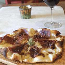 Have a pear and taleggio pizza with a drink at happy hour.