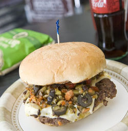Inspired: The combination of olive salad and burger meat in the muffuletta burger.