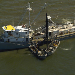 Menhaden carrier vessels are equipped with two purse boats that gather the fish...