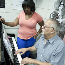Sample breaks down a piece of music for TSU student and pianist Britney Bloom. The university, which is attempting to reinvent itself following a series of public embarrassments, competes for the best students with the music schools at Rice University, University of Houston and University of North Texas.