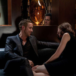 Jacob (Ryan Gosling, left) teaches Cal (Steve Carell, center) the art of anonymous sex.