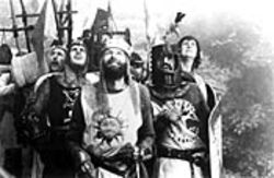 Quit groveling: Python geeks will descend upon theaters to pay their respects to the rerelease of Monty Python and the Holy Grail.