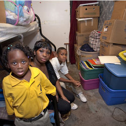 Shundrekia Edwards lives with her sons Jaylyn, 4, and Jamarcus, 11, in one room of her parents' house.