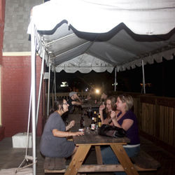 Rachael DeBlanc (left) and friends catch up on Cecil&#039;s patio.