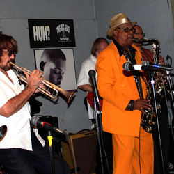 Grady Gaines (orange suit) & the Texas Upsetters' blues and R&B standards usually pack the dance floor at The Big Easy.