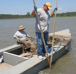 Mary and Tom Green harvest Apalachicola oysters with tongs, which does less damage to oyster reefs.