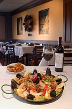 Rioja calls itself a tapas restaurant, but the paella is  the main attraction.
