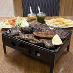 The parrillada overflows with nearly every cut of cow.