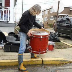 Jerry Gaskill tries to rescue his drums outside his wrecked New Jersey home.