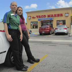 Wanda Figueroa (left) and her daughter, Zuleyka Perez, stand in the spot where a Puerto Rico police officer shot Figueroa's two sons.