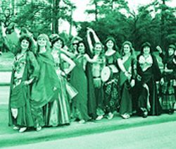 The Sirrom School of Belly Dance is just one of the roadside attractions encouraging the runners at the Compaq Houston Marathon.