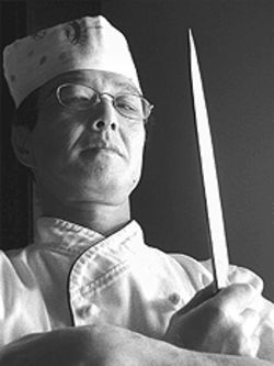 Chef Kubo wields his knife with the skill of a samurai.