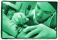 Robert-Michael goes over the incisions again to ensure they are even and connected.