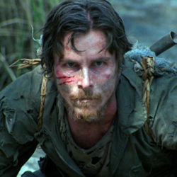 Dieter (Christian Bale) is tied down for the entertainment of the sadistic rabble.