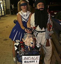 Osama, his captive cheerleader and his scooter, replete with a severed Dubya's head.