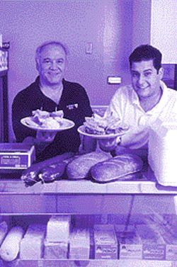 Meat men: Victor Tayeri (left) and manager Tony Galati know how to pile on the corned beef.