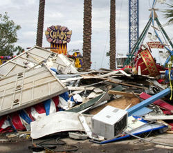 "The sign says ""Chaos"" and it doesn't lie, as the debris grows high on the Kemah boardwalk."