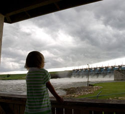 Malsie Mackay, four, watches the high waters come in over Lake Livingston dam. To view more shots by Daniel Kramer, click here.