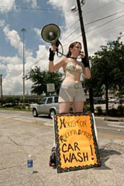Rollergirls + bikini car wash = marketing genius.