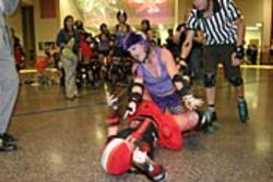 "Mistilla ""the killa"" (reclining) and Becky Booty discuss the finer  points of the game."