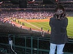 A lonely Astros fan watches the White Sox celebrate.