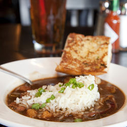 The Louisiana-style gumbo has a dark, thick roux.