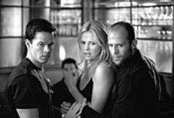 Mark Wahlberg, Charlize Theron and Jason Statham speak the shorthand slang of the con.