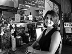 Shelley Elham is a partner at District 7, where customers like their muffulettas on the unauthentic side.