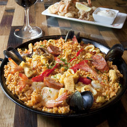 Go for the tortilla or the fritura de mariscos instead of the paella (above).