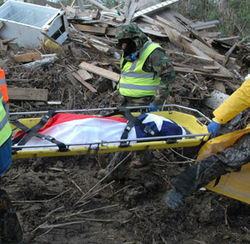 The crew pulled a body out from under ten feet of debris and wrapped it in a Texas flag.