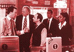Snowed under: Trapped in a Colorado diner during a blizzard while Iraqis attack Kuwait, the president's chief of staff (Timothy Hutton, left) wants to know who's paying for the chili burgers.