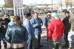 Juan Alvarez (center) tells workers about their rights.