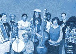 With only three original members remaining, the Skatalites (led by drummer Lloyd Knibbs, kneeling) continue to generate substantial ska.