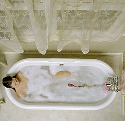 Kylie (Tania Saulnier) enjoys a relaxing bath with an unexpected visitor.