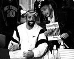 Powell's always in the right spot: Here, next to basketball great Walt Frazier (left).