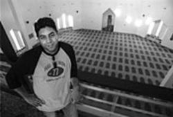 All grown up: Mirza Baig at his hometown mosque on  Adel Road.