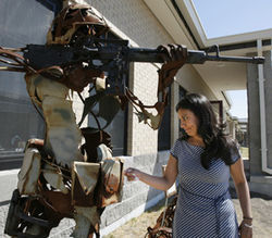 Monica Velez cleans a statue dedicated to her brother Freddy at Fort Hood, the home to his unit, the 2nd Battalion of the 7th Cavalry Regiment, 1st Cavalry Division. Freddy Velez was killed by sniper fire in Iraq in 2004 while defending wounded members of his squad.